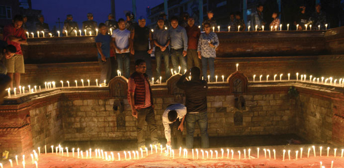Nepalese youths light candles during an event to celebrate Nepal's new national constitution in Kath