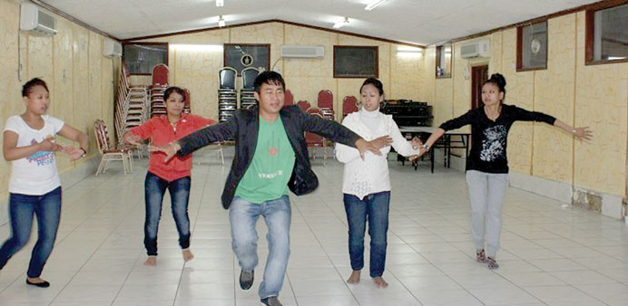 Jerry Rai shows a dance move to his students at NCC.