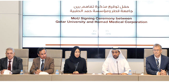 QU and HMC officials at the signing ceremony.