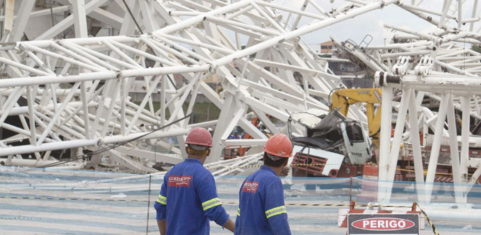 Work resumes at Brazil arena hit by deaths