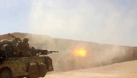 Afghan  Army commandos open fire on a Taliban position in Helmand province