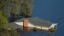 A home is seen under water after Hurricane Matthew in Lumberton, North Carolina