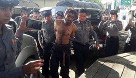 A man suspected of being one of the attackers is taken to a police station in Sittwe,  Rakhine