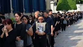 As Thais mourn, tourists warned not to behave badly