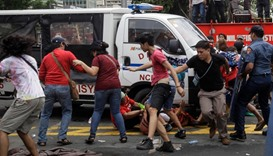 Philippine police van drives at protesters to break up anti-US demo
