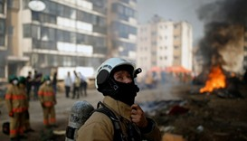 A firefighter takes part in a large-scale earthquake simulation exercise in Seoul