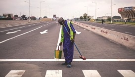 A public cleaner works on a deserted avenue as the Congolese capital Kinshasa was gripped by a strik