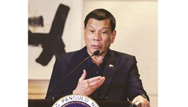 President Rodrigo Duterte attends a news conference during his visit in Beijing yesterday.