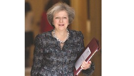 Prime Minister Theresa May leaves 10 Downing Street in London yesterday ahead of the weekly Prime Mi