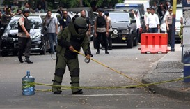 A bomb squad policeman inspect a bomb suspected object at location