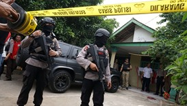 Anti-terror police secure the residence of a suspect, who attacked several policemen on duty