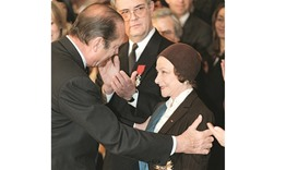 This file photo taken on March 3, 1998 shows then-French president Jacques Chirac awarding Chauvire