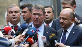 US Defense Secretary Ash Carter, accompanied by Turkey's Defense Minister Fikri Isik (R)