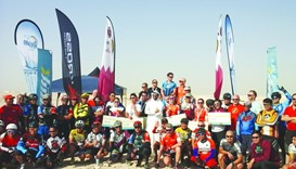 Winners of QCR's MTB Championship join other participants and Farhan-al-Sayed in celebrating their v