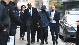 Mazher Mahmood (centre) arrives at the Old Bailey Central Criminal Court in central London yesterday