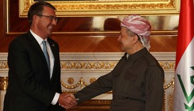 Iraqi Kurdish leader Massud Barzani (R) shakes hands with US Secretary of Defence Ashton Carter ahea