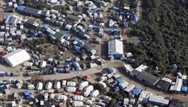 An aerial view shows tents and makeshift shelters in Calais