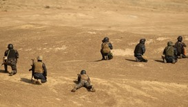 Members of Iraqi forces take position