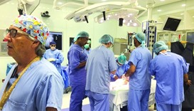 Dr Joao Luiz Pippi Salle (left) briefing the family during the recent surgery.