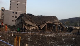 A collapsed house is seen at site after an explosion hit a town in Fugu county, Shaanxi province, Ch