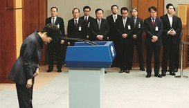 President Park bows after releasing the statement of apology to the public during a news conference