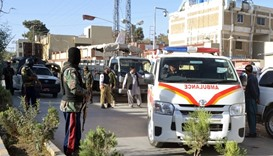 Ambulances  take the dead from the hospital to be buried after they were killed in an attack on the