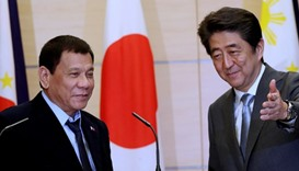 Philippine President Rodrigo Duterte with Japan's Prime Minister Shinzo Abe