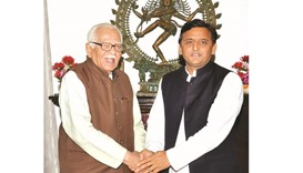 Uttar Pradesh Chief Minister Akhilesh Yadav shakes hands with Governor Ram Naik before their talks i