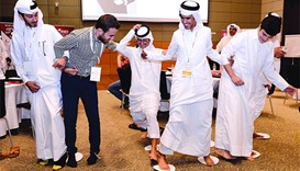 Some of the participants engage in a team building activity during a workshop
