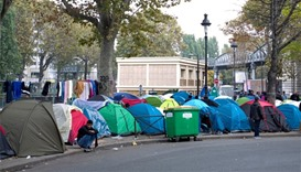 Tents are seen at a makeshift migrant camp on a street near the metro stations of Jaures and Staling