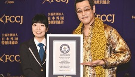 Pikotaro shows his Guinness World Records certificate during a press conference at the Foreign Corre