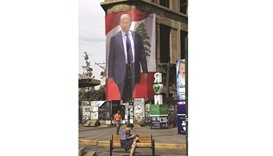 A giant poster that bears the portrait of Lebanese presidential candidate Michel Aoun is seen hangin