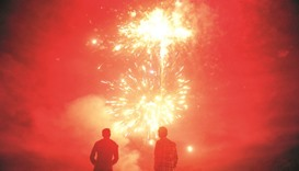 Indian athletes watch fireworks at the Madan Mohan Malviya stadium on the eve of the festival of Diw