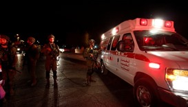 Israeli soldiers stand guard near the scene of a shooting attack by a Palestinian