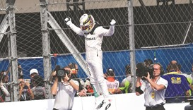 Hamilton wins but Rosberg has one hand on title