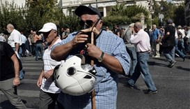 Greek police fire tear gas at pensioners during Athens protest