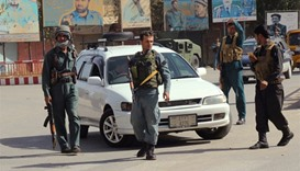 Afghan policemen keep watch in the downtown of Kunduz city