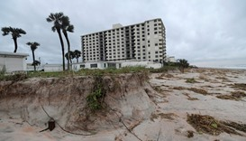 Beach erosion caused by a storm surge is seen at Ormond Beach, Florida