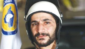 Abu Yasser, a White Helmets Syrian civil defence volunteer poses for a picture in the rebel-held tow
