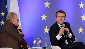 French President Emmanuel Macron (R) speaks next to European MP Daniel Cohn-Bendit (L)