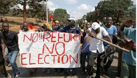 Supporters of Kenyan opposition National Super Alliance (NASA) coalition, carry a banner as they dem