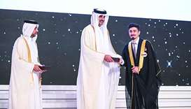 His Highness the Emir Sheikh Tamim bin Hamad al-Thani honours a graduate.