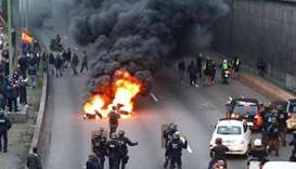 Police cars burn in violent Paris protests