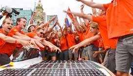 "Crew members of the Dutch team ""Nuon"" celebrate after winning in the World Solar Challenge"