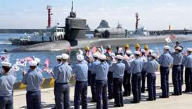 The Ohio-class guided-missile submarine USS Michigan pulls into Busan Naval Base in South Korea