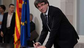 Catalan regional government president Carles Puigdemont signs a document about the independence of C