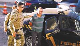 Fugitive Battisti says extradition from Brazil 'illegal'