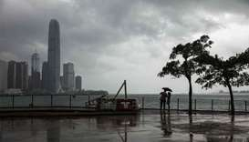 Typhoon Khanun to hit southern China Monday as Hong Kong eases warning
