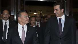 Malaysia's Minister of Defense Hishammuddin Hussein receives His Highness the Emir Sheikh Tamim bin