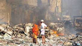 A man and woman look at the damages on the site of the explosion of a truck bomb in the centre of Mo